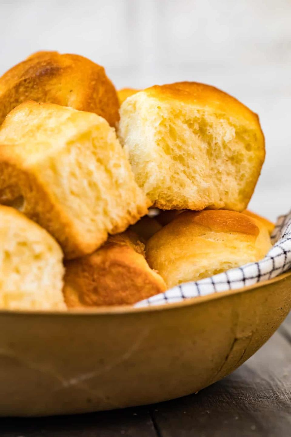"""<p>If you want to make Thanksgiving dinner a breeze, we suggest whipping up these rolls ahead of time. Pair them with butter, jam, gravy, or honey, and enjoy them in between bites of turkey and stuffing.</p> <p><strong>Get the recipe</strong>: <a href=""""https://www.thecookierookie.com/make-ahead-yeast-rolls/"""" class=""""link rapid-noclick-resp"""" rel=""""nofollow noopener"""" target=""""_blank"""" data-ylk=""""slk:make-ahead yeast rolls"""">make-ahead yeast rolls</a></p>"""