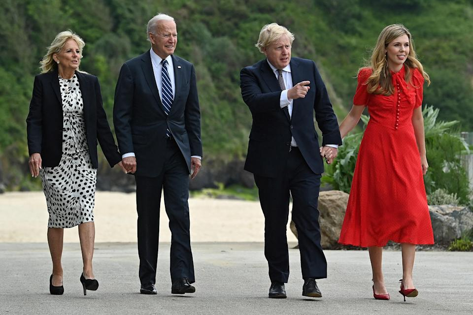 British Prime Minister Boris Johnson and his wife Carrie Johnson walk with U.S. President Joe Biden and First Lady Jill Biden prior to a bilateral meeting at the G7 summit in Cornwall, U.K.