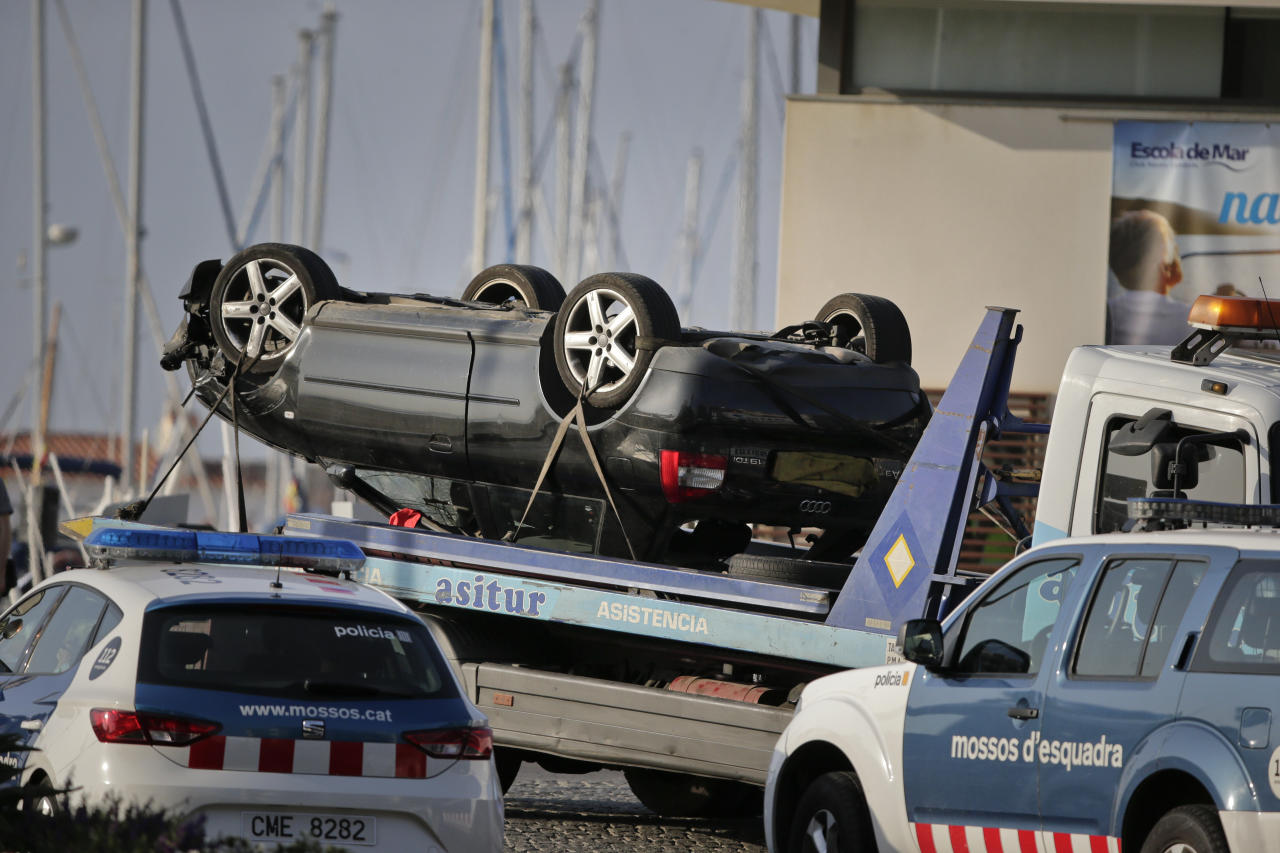 <p>An overturned car is transported on a platform from the spot where terrorists were intercepted by police in Cambrils, Spain, Friday, Aug. 18, 2017. (Photo: Emilio Morenatti/AP) </p>