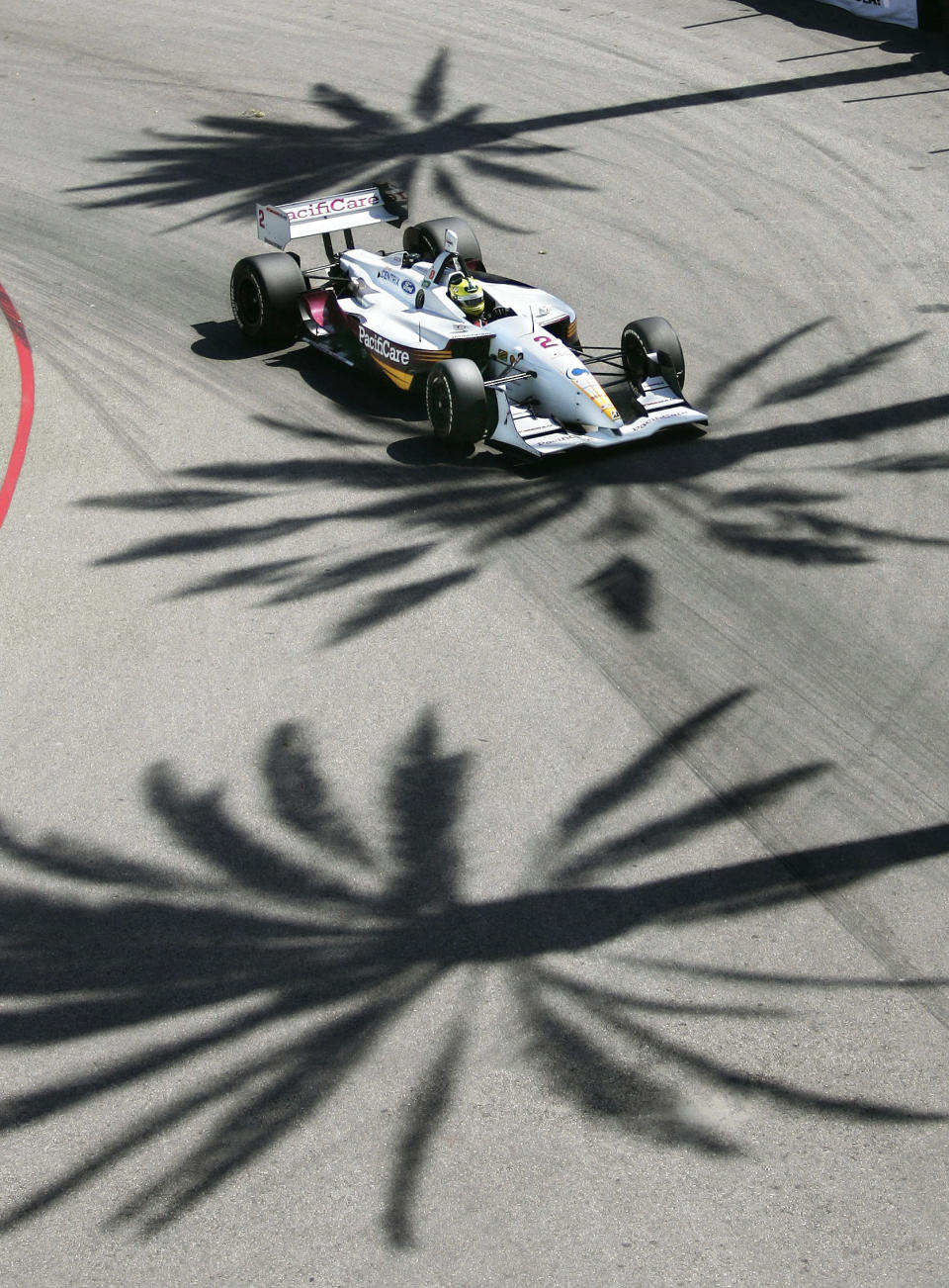 FILE - Bruno Junqueira of Brazil goes through turn three during the first day qualifying for Champ Car's Toyota Grand Prix of Long Beach, in Long Beach, Calif., in this Friday, April 8, 2005, file photo. The Grand Prix of Long Beach opens 17 months after the pandemic ended the crown jewel's streak as one of the longest continuously-running street events in racing. (AP Photo/Mark J. Terrill, File)
