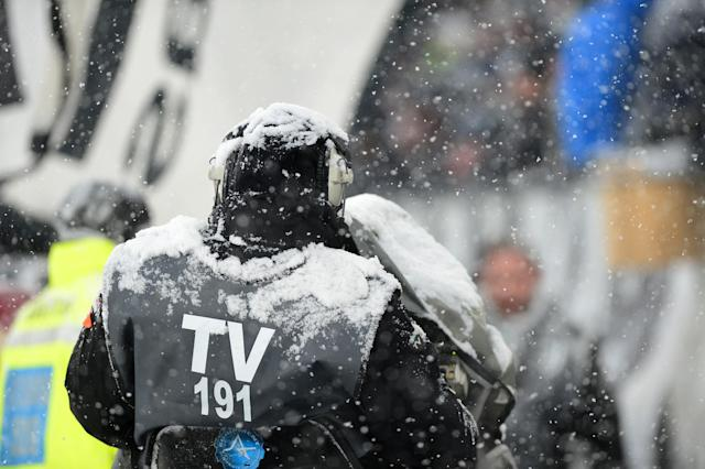 Soccer Football - Serie A - Juventus v Atalanta - Allianz Stadium, Turin, Italy - February 25, 2018 General view of a cameraman in the snow before the match was postponed REUTERS/Massimo Pinca