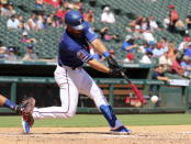 Texas Rangers' Jeff Mathis hits a two-run single in the third inning of a baseball game against the Minnesota Twins, Sunday, Aug. 18, 2019, in Arlington, Texas. (AP Photo/Richard W. Rodriguez)