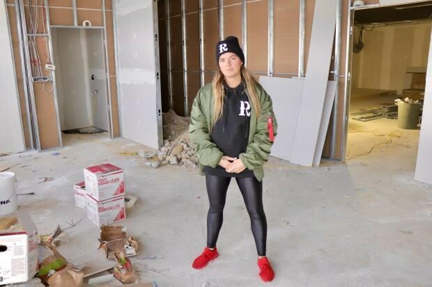 Connie McInnes stands in the space where she wants to open a new spin studio in Halifax.  (Paul Palmeter/CBC - image credit)