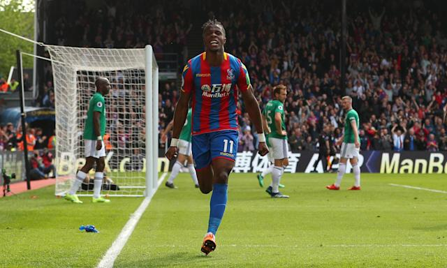 Wilfried Zaha celebrates after giving Crystal Palace the lead against West Brom.