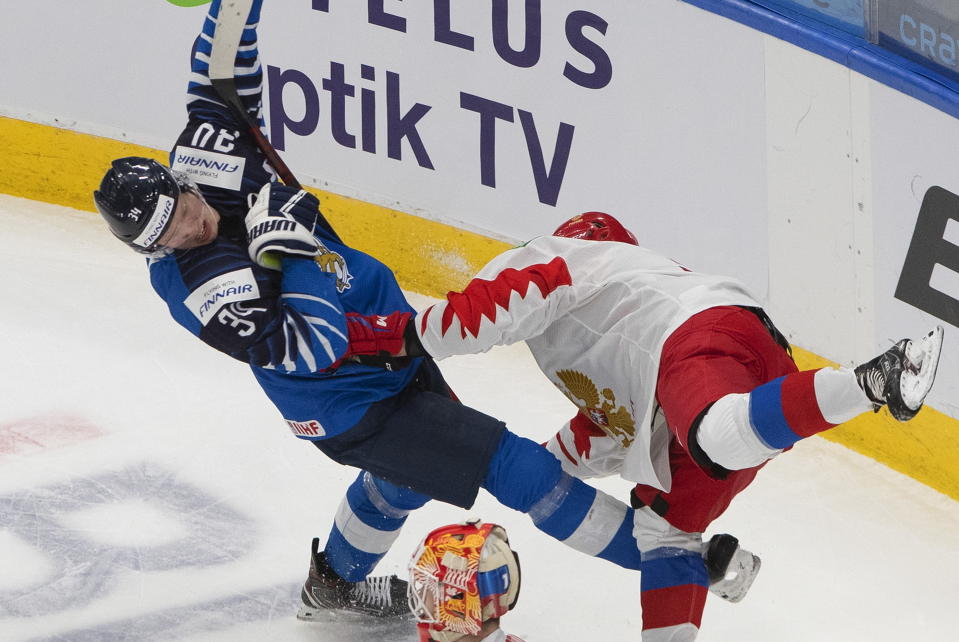 Russia's Artemi Knyazev, right, checks Finland's Aku Raty (34) during the third period of the third-place game in the IIHF World Junior Hockey Championship, Tuesday, Jan. 5, 2021, in Edmonton, Alberta. (Jason Franson/The Canadian Press via AP)