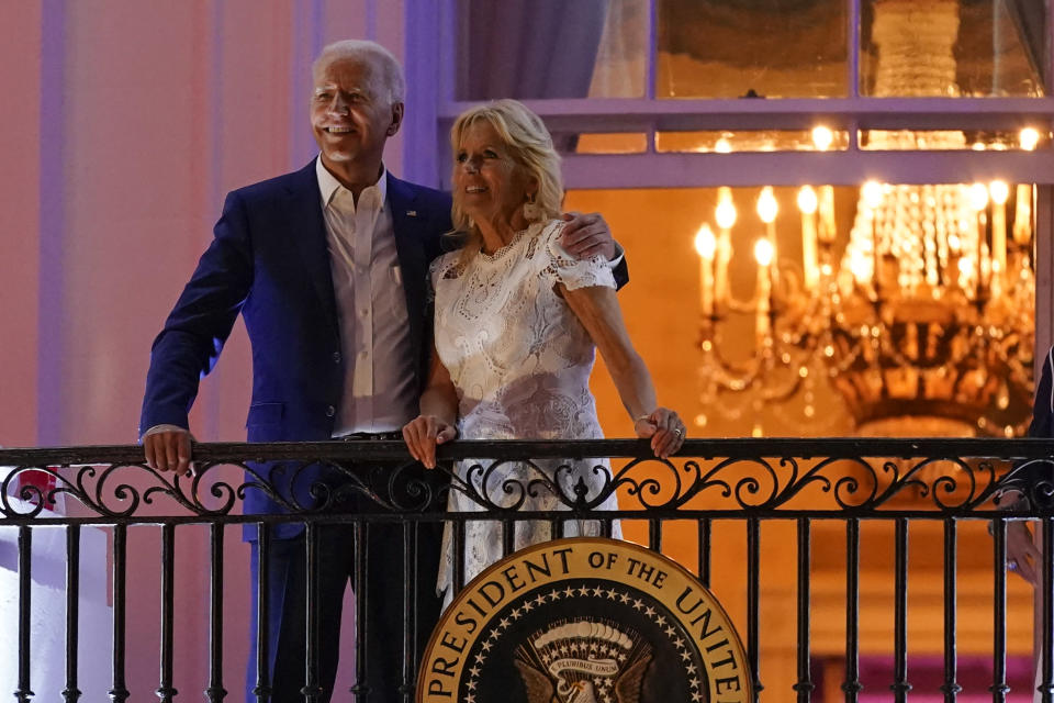 President Joe Biden and first lady Jill Biden view fireworks during an Independence Day celebration on the South Lawn of the White House, Sunday, July 4, 2021, in Washington. (AP Photo/Patrick Semansky)
