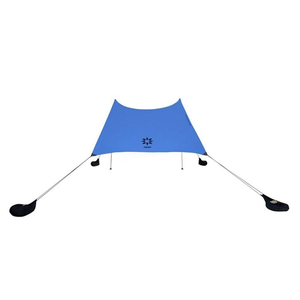 """<p><strong>Neso Tents</strong></p><p>rei.com</p><p><strong>$94.95</strong></p><p><a href=""""https://go.redirectingat.com?id=74968X1596630&url=https%3A%2F%2Fwww.rei.com%2Fproduct%2F123573&sref=https%3A%2F%2Fwww.menshealth.com%2Fstyle%2Fg21753744%2Fbeach-essentials%2F"""" rel=""""nofollow noopener"""" target=""""_blank"""" data-ylk=""""slk:BUY IT HERE"""" class=""""link rapid-noclick-resp"""">BUY IT HERE</a></p><p>This lightweight portable beach tent is a no-brainer choice over standard sun umbrellas with the ability to stay in position, even in the windiest conditions. </p>"""