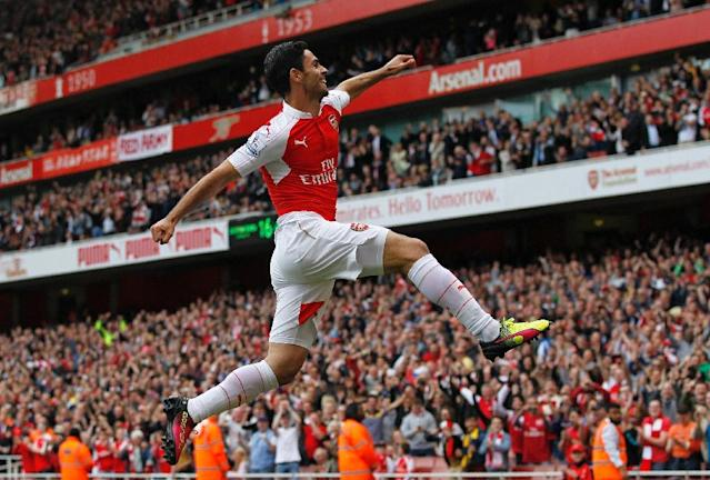 Arsenal's midfielder Mikel Arteta celebrates scoring his team's fourth goal on May 15, 2016 (AFP Photo/Ian Kington)