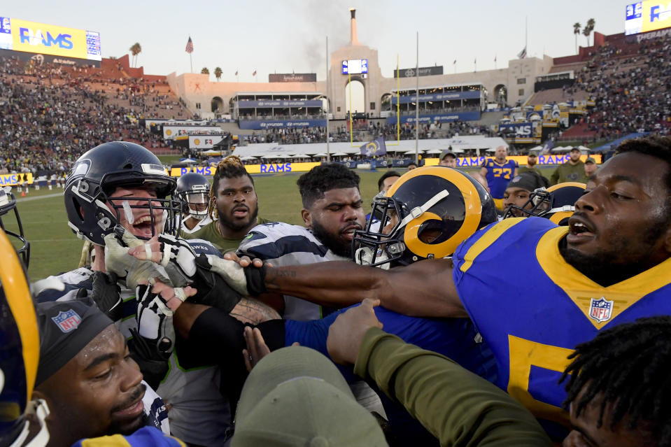 The Rams, mixing it up with some Seahawks last Sunday, look forward to playing a home game in L.A. instead of the originally scheduled Mexico City. (AP)