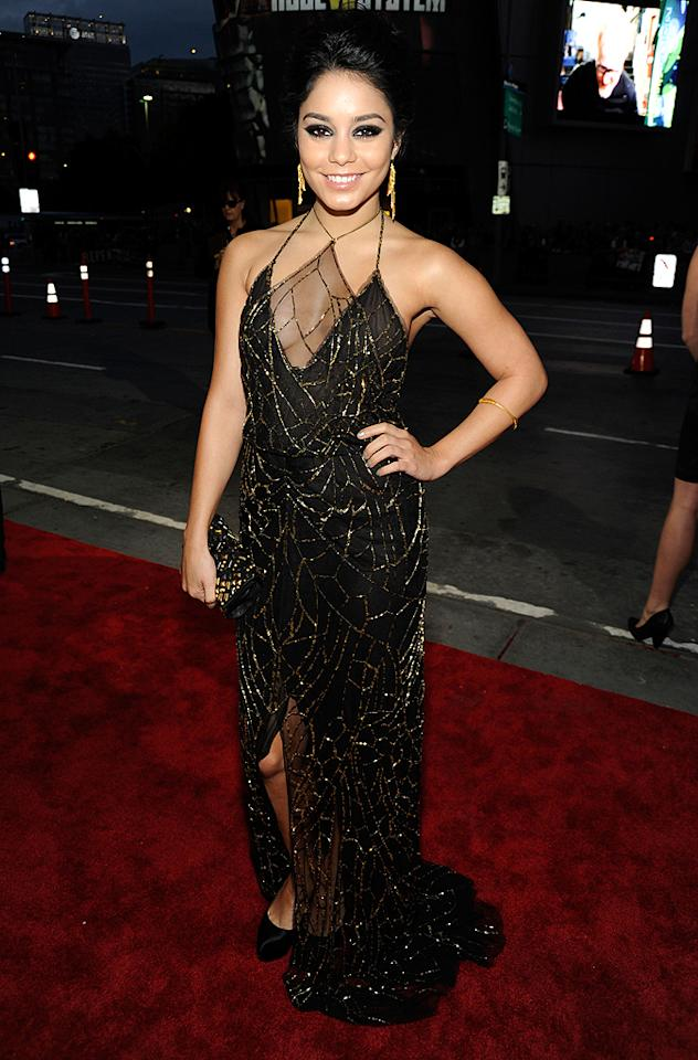 Vanessa Hudgens looked like Spider-Woman in her black-and-gold gown and dangling earrings. (01/11/2012)