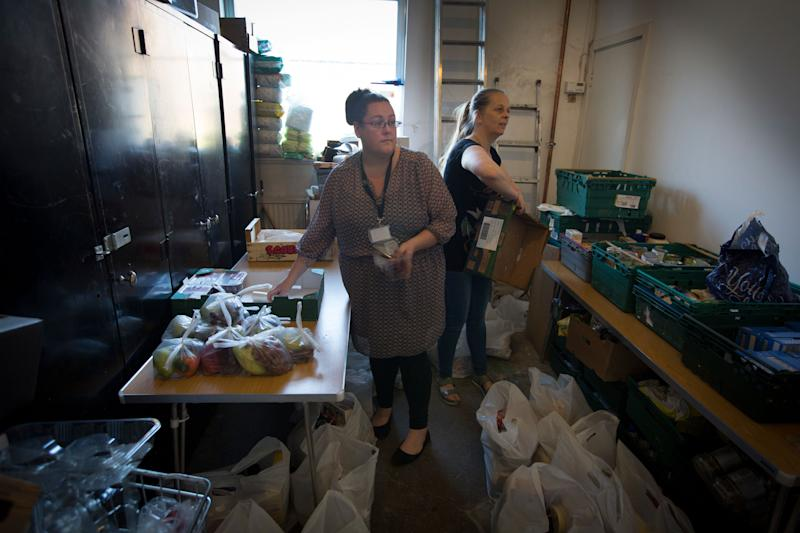 Volunteers at the Orchard food bank in Garston, Liverpool. (Photo: Colin McPherson via Getty Images)
