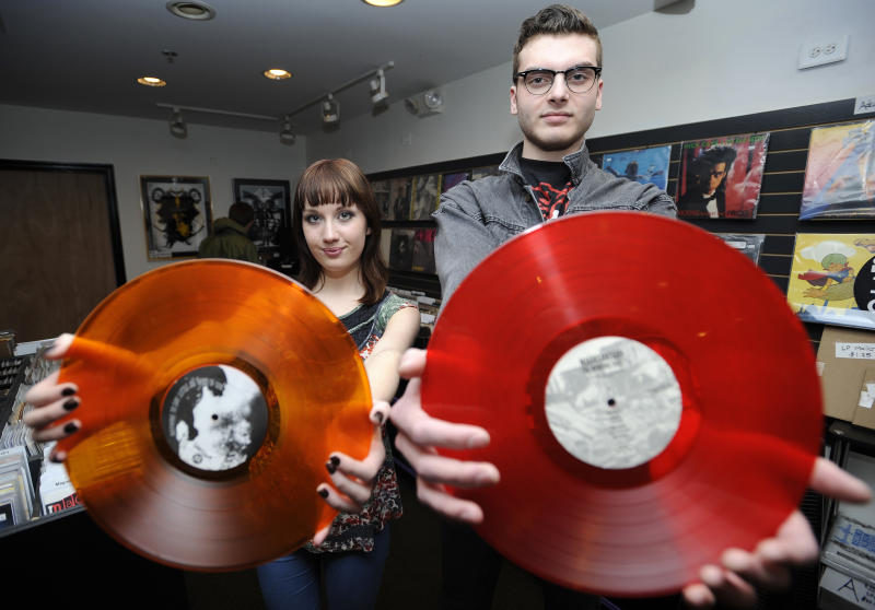 This March 10, 2011 photo shows Sarah McCarthy, 16, of Centreville, Md., left, and her boyfriend Jack Carroll, 19, of Bowie, Md., as they pose for a photograph at KA-CHUNK!! Records in Annapolis, Md. In most ways, Sarah McCarthy is your average high schooler. She has a job, college plans, but also a peculiar passion for vinyl records.   (AP Photo/Nick Wass)