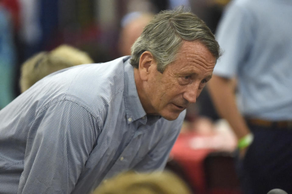 Former U.S. Rep. Mark Sanford speaks with attendees at U.S. Rep. Jeff Duncan's annual fundraiser on Monday, Aug. 26, 2019, in Anderson, S.C. Sanford is mulling a 2020 GOP challenge to President Donald Trump. (AP Photo/Meg Kinnard)