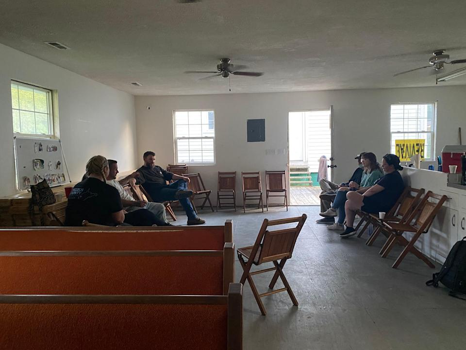 A recovery meeting at Daniel Adkins' church in East Lynn, West Virginia (Richard Hall / The Independent)