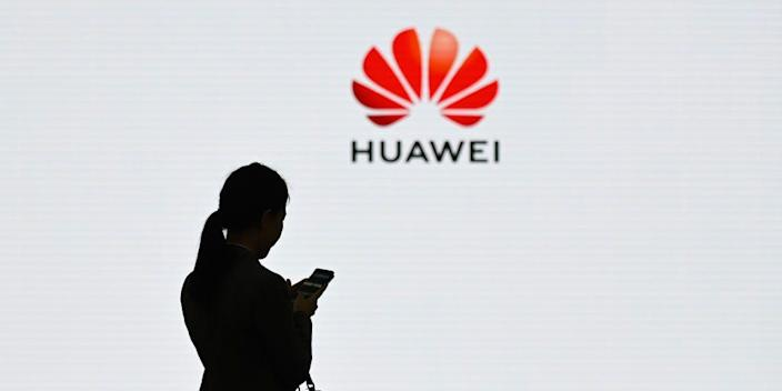 A staff member of Huawei using her mobile phone at the Huawei Digital Transformation Showcase in Shenzhen, in China's Guangdong province, on March 6, 2019.