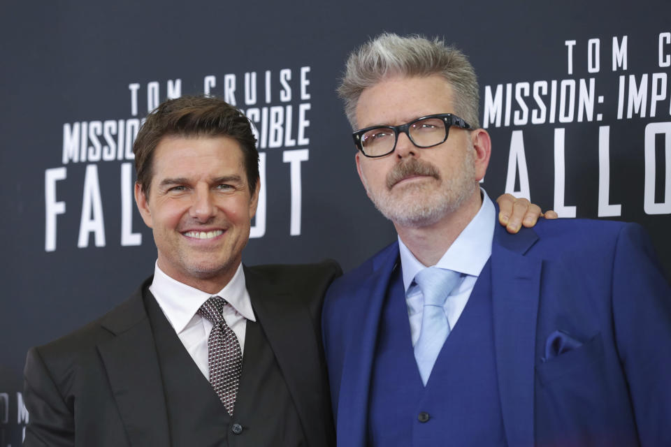 """Actor Tom Cruise, left, and director, writer, producer Christopher McQuarrie attend the U.S. premiere of """"Mission: Impossible – Fallout"""" at The Smithsonian National Air and Space Museum on Sunday, July 22, 2018 in Washington. (Photo by Brent N. Clarke/Invision/AP)"""