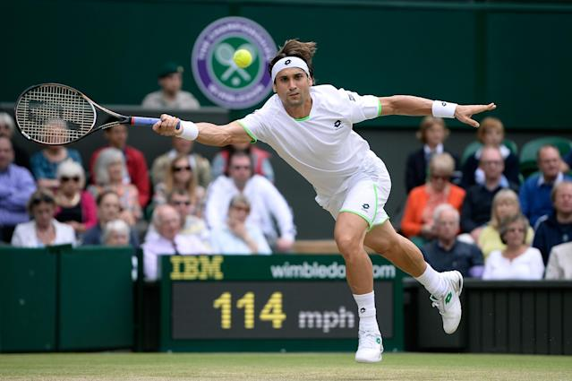 LONDON, ENGLAND - JULY 03: David Ferrer of Spain plays a forehand during the Gentlemen's Singles quarter-final match against Juan Martin Del Potro of Argentina on day nine of the Wimbledon Lawn Tennis Championships at the All England Lawn Tennis and Croquet Club at Wimbledon on July 3, 2013 in London, England. (Photo by Dennis Grombkowski/Getty Images)
