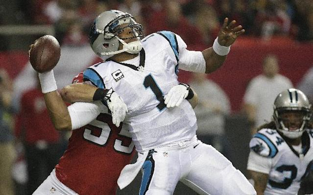 Carolina Panthers quarterback Cam Newton (1) is hit by Atlanta Falcons outside linebacker Paul Worrilow (55) during the first half of an NFL football game, Sunday, Dec. 29, 2013, in Atlanta. The play was ruled as a incomplete pass. (AP Photo/Dave Martin)