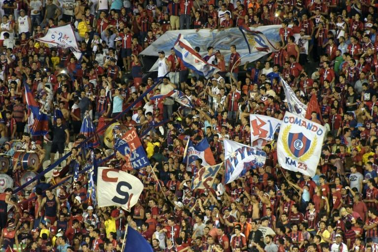 Fans of Paraguay's Cerro Porteno cheer for their team during their Copa Libertadores 2016 football match against Colombia's Independiente de Santa Fe at Defensores del Chaco stadium in Asuncion, on April, 20, 2016