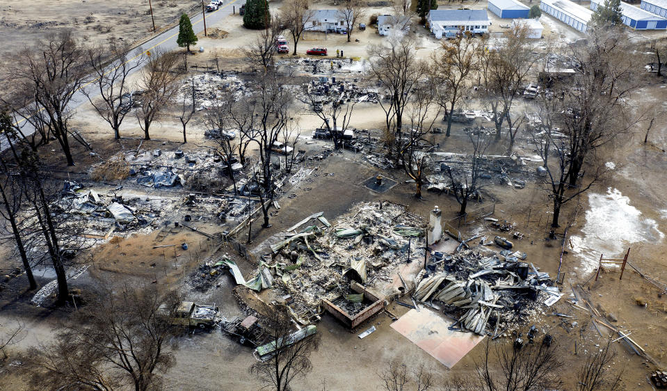 In this photo taken by a drone, residences destroyed by the Mountain View Fire line a street in the Walker community in Mono County, Calif., Wednesday, Nov. 18, 2020. (AP Photo/Noah Berger)