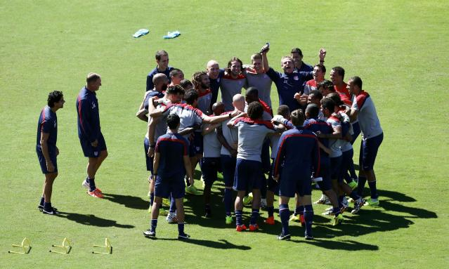 U.S. national soccer team coach Juergen Klinsmann raises his arms as his team gathers during a training session ahead of their 2014 World Cup round of 16 match against Belgium in Salvador, June 30, 2014. REUTERS/Marcos Brindicci (BRAZIL - Tags: SPORT SOCCER WORLD CUP)