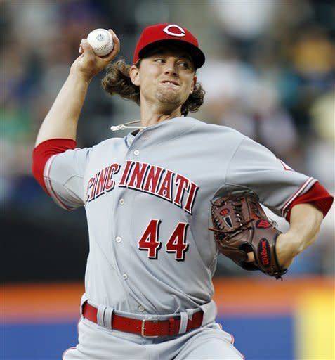 Cincinnati Reds starting pitcher Mike Leake delivers in the first inning against the New York Mets during their baseball game at Citi Field in New York, Wednesday, May 16, 2012. (AP Photo/Kathy Willens)