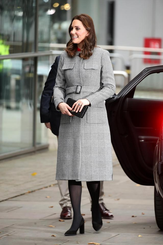 The royal, who's expecting her third baby, wore a red dress from Goat under her L.K.Bennett coat. (Photo: Getty Images)