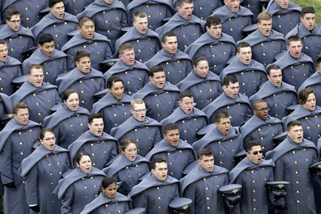Army cadets shout before the first half of an NCAA college football game against the Navy, Saturday, Dec. 14, 2013, in Philadelphia. (AP Photo/Matt Rourke)