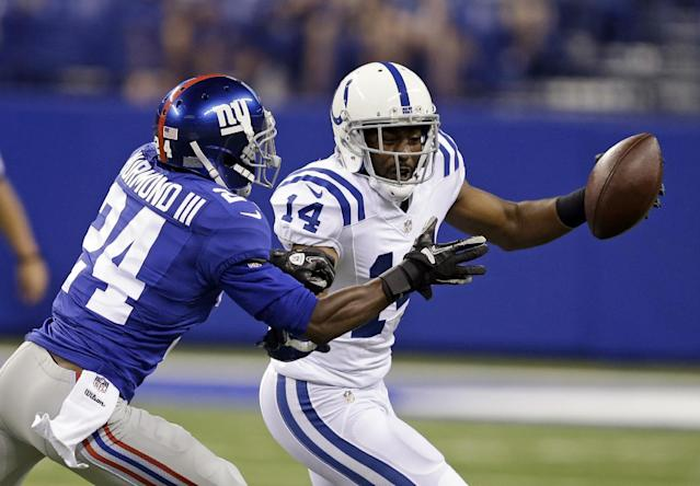 Indianapolis Colts wide receiver Hakeem Nicks (14) is tackled by New York Giants cornerback Walter Thurmond during the first half of an NFL preseason football game Saturday, Aug. 16, 2014, in Indianapolis. (AP Photo/Darron Cummings)