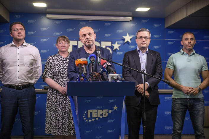Former deputy prime minister Tomislav Donchev, center, and GERB political party officials attend a news conference in capital Sofia, Bulgaria on Sunday, July 11, 2021. Voter apathy dominated Bulgaria's early election on Sunday, raising the prospect of yet another fractured parliament that will struggle to form a viable governing coalition. (AP Photo/Visar Kryeziu)