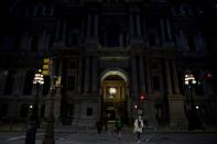 Philadelphia City Hall, an early voting location for the upcoming presidential election, is illuminated at night in Philadelphia, Pennsylvania