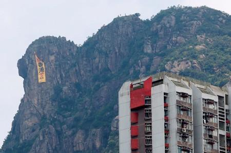 """A large banner protesting against the extradition bill that reads, """"Fight for HK"""" hung by pro-democracy protesters is seen in Hong Kong"""