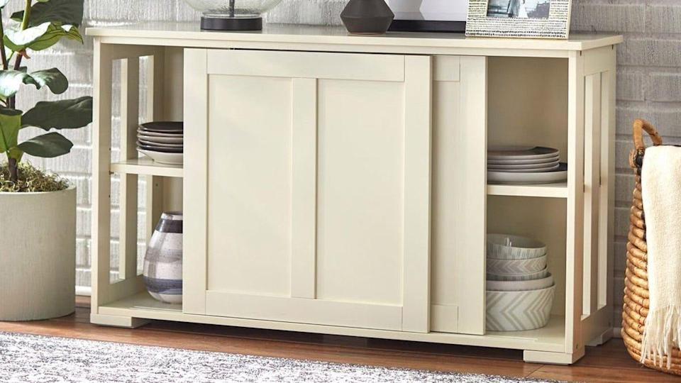 This sliding-door cabinet is stackable, so you can expand your storage space with ease.