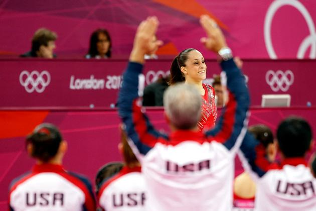 LONDON, ENGLAND - JULY 31:  Jordyn Wieber of the United States reacts after her floor exercise as her teammates cheer her on in the Artistic Gymnastics Women's Team final on Day 4 of the London 2012 Olympic Games at North Greenwich Arena on July 31, 2012 in London, England.  (Photo by Jamie Squire/Getty Images)