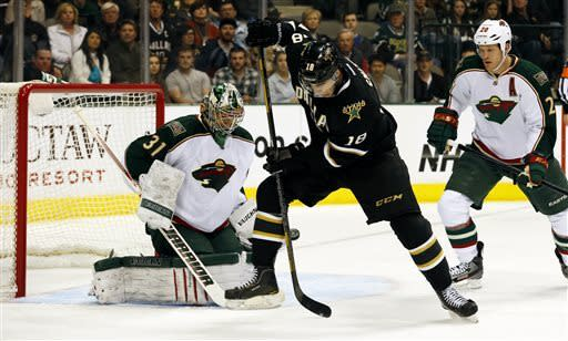 Minnesota Wild goalie Matt Hackett (31) and defenseman Ryan Suter (20) defend as Dallas Stars forward Reilly Smith (18) jumps out of the way of the puck during the first period of an NHL hockey game Friday, March 29, 2013, in Dallas, Texas. (AP Photo/Sharon Ellman)