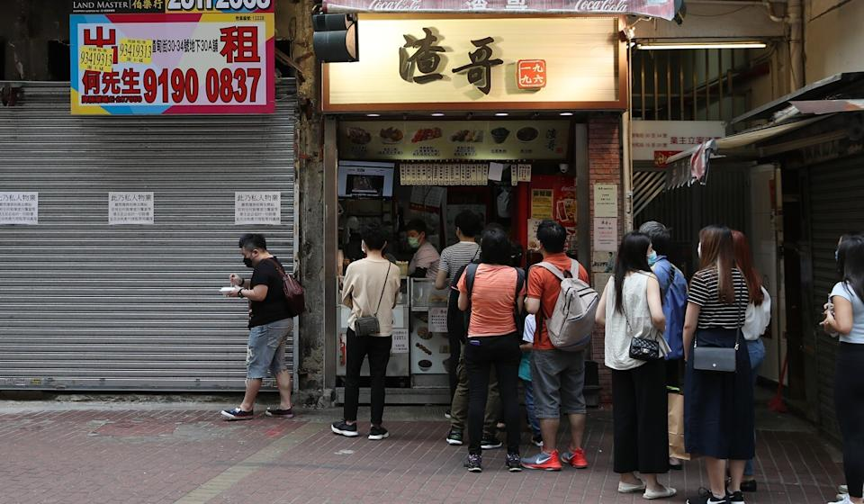 Residents line up at a snack shop that supports the protest movement. Photo: Winson Wong