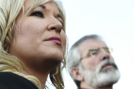 Sinn Fein leader Michelle O'Neill and Sinn Fein President Gerry Adams speak to media outside the Sinn Fein offices on Falls Road in Belfast, Northern Ireland March 4, 2017. REUTERS/Clodagh Kilcoyne