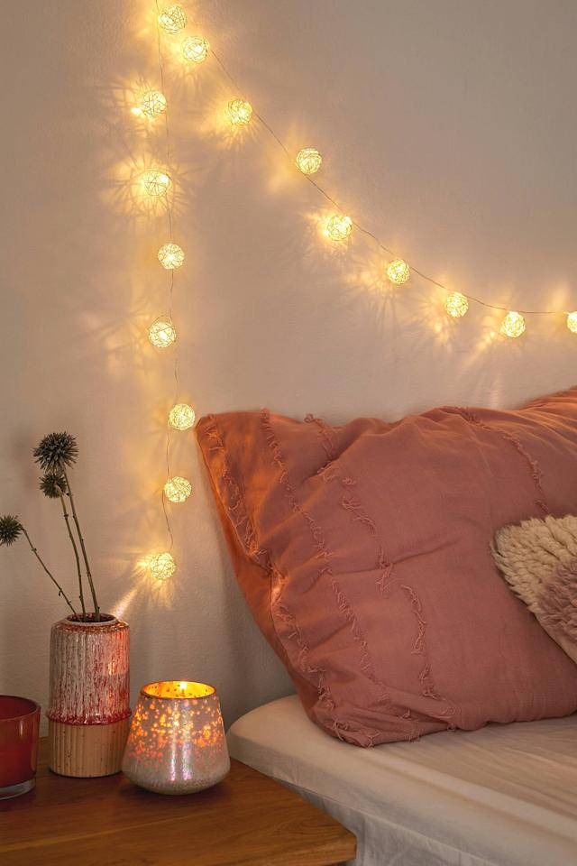 """<p>Hang these <a href=""""https://www.popsugar.com/buy/Woven-Globe-String-Lights-494310?p_name=Woven%20Globe%20String%20Lights&retailer=urbanoutfitters.com&pid=494310&price=20&evar1=savvy%3Aus&evar9=46677767&evar98=https%3A%2F%2Fwww.popsugar.com%2Fsmart-living%2Fphoto-gallery%2F46677767%2Fimage%2F46678721%2FWoven-Globe-String-Lights&list1=shopping%2Curban%20outfitters%2Cgift%20guide&prop13=mobile&pdata=1"""" rel=""""nofollow"""" data-shoppable-link=""""1"""" target=""""_blank"""" class=""""ga-track"""" data-ga-category=""""Related"""" data-ga-label=""""https://www.urbanoutfitters.com/shop/woven-globe-string-lights?category=SEARCHRESULTS&amp;color=010"""" data-ga-action=""""In-Line Links"""">Woven Globe String Lights</a> ($20) above your bed.</p>"""