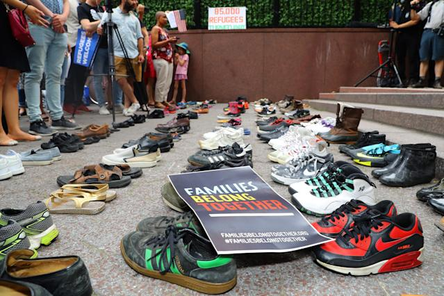 85 pairs of shoes representing 85,000 refugees excluded by the Trump administration sit in Dag Hammarskjold Plaza across from the United Nations in New York City on June 20, 2018. (Photo: Gordon Donovan/Yahoo News)
