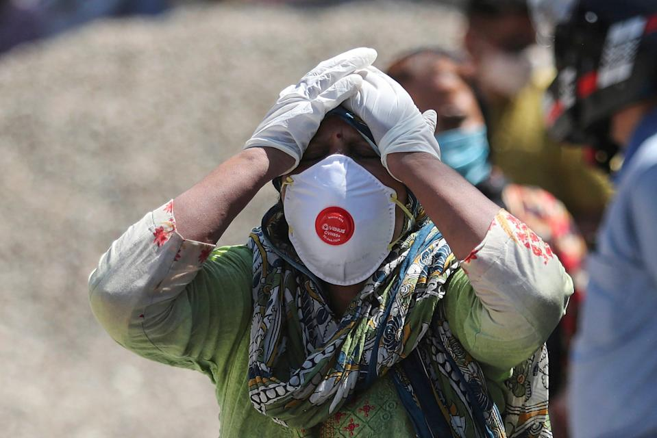 <p>A relative of a person who died of Covid-19 reacts at a crematorium in Jammu, India</p> (A/Channi Anand, File)