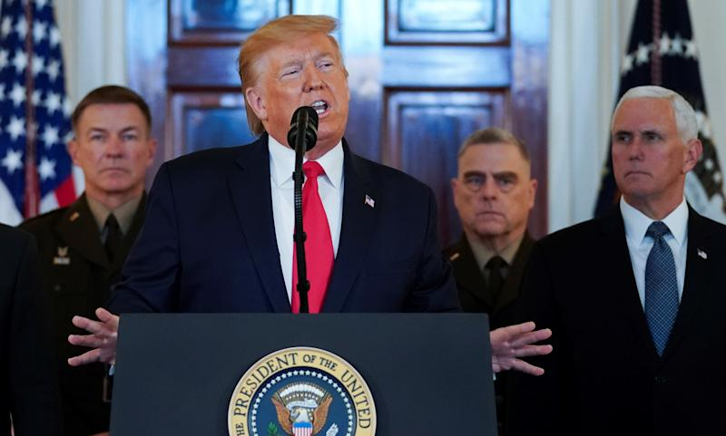 U.S. President Donald Trump delivers a statement about Iran flanked by U.S. Army Chief of Staff General James McConville, Chiarman of the Joint Chiefs of Staff Army General Mark Milley and Vice President Mike Pence in the Grand Foyer at the White House in Washington, U.S., January 8, 2020. REUTERS/Kevin Lamarque