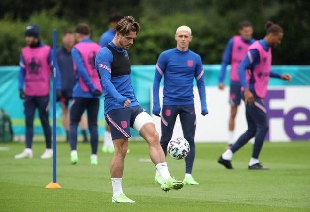 Jack Grealish was spotted with strapping on his left thigh at training on Monday