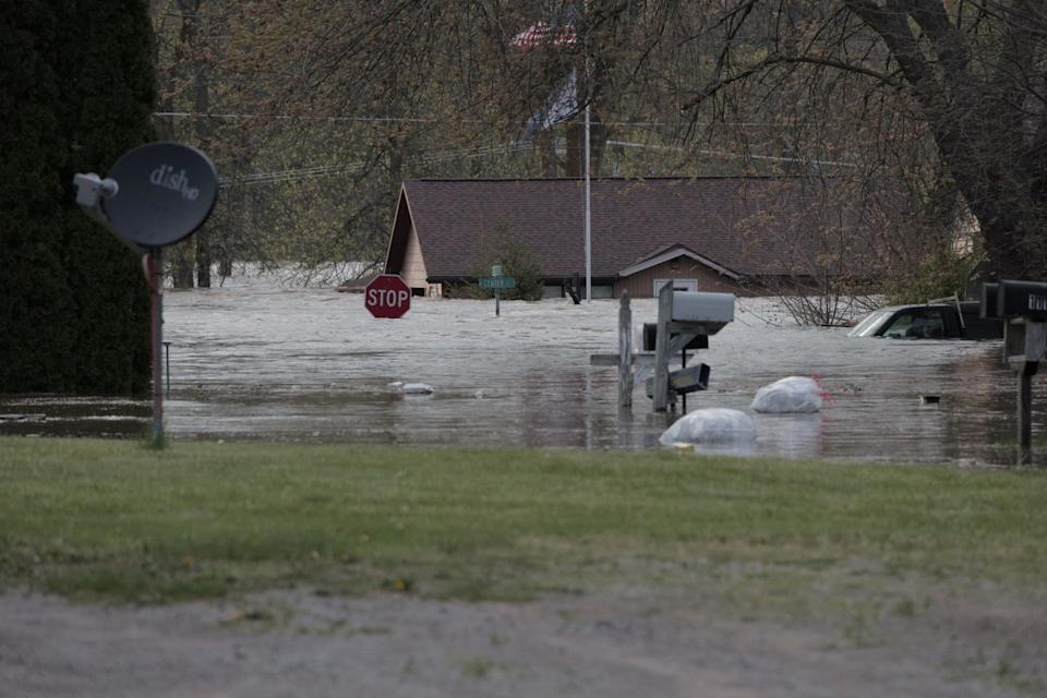 Floodwaters are seen along a street in downtown Sanford, Michigan, in this May 19, 2020, picture obtained from social media.