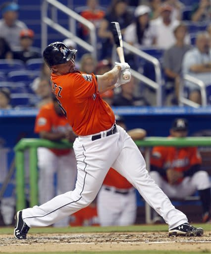 Miami Marlins' Gaby Sanchez follows through on his home run against the New York Yankees in the second inning of a spring training baseball game in Miami, Sunday, April 1, 2012. (AP Photo/Alan Diaz)