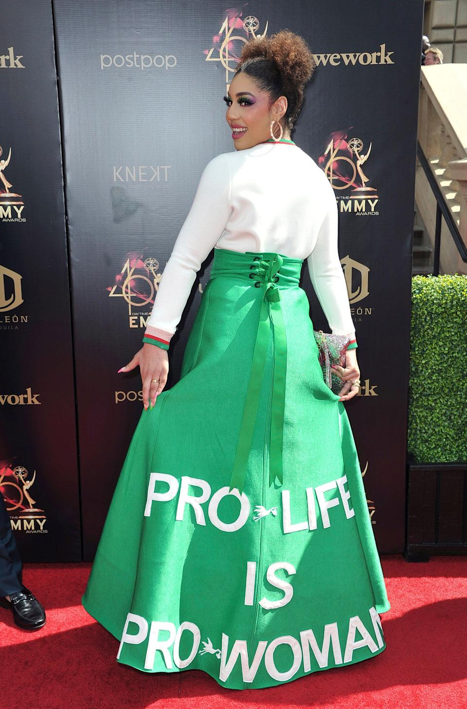"""Joy Villa arrives wearing a dress saying """"Pro-Life Is Pro-Woman"""" at the 46th annual Daytime Emmy Awards at the Pasadena Civic Center, Sunday, May 5, 2019, in Pasadena, Calif. (Photo by Richard Shotwell/Invision/AP)"""