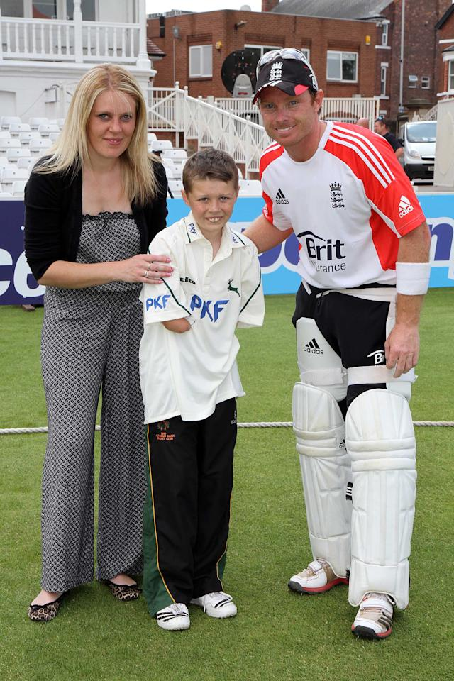 NOTTINGHAM, UNITED KINGDOM - JULY 28: Carrie, (Kearan's Mum), (L) and Kearan Gibbs (C) meet  with Ian Bell (R) as England prepare for the second test match against India at Trent Bridge on July 28, 2011 in Nottingham, England. Kearan Gibbs, 11, today met some of his cricketing heroes from the England national team after attending a training session at  Trent Bridge, Nottingham. Kearan is a young cricketing prodigy who is amazing his peers in the sport as he is proving to be a talented bowler and batsman - despite being born with no arms from the elbow down.(Photo by Mathew Growcoot/Newsteam/Getty Images)