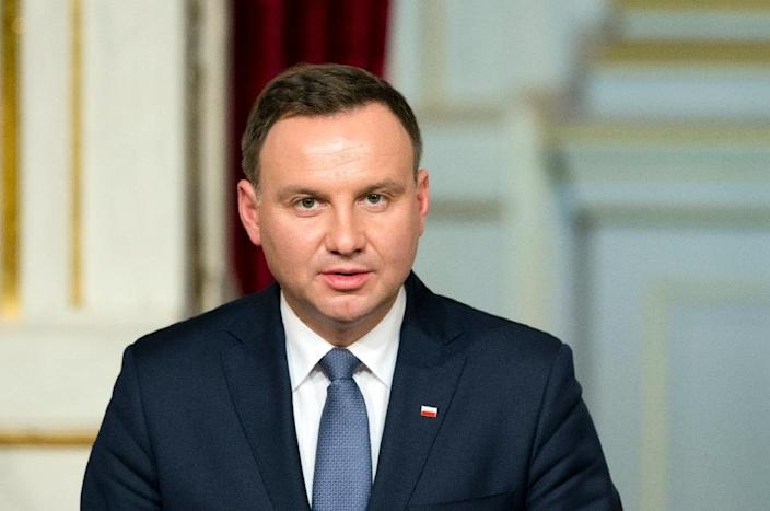 Poland's PiS-backed President Andrzej Duda signed into law a bill giving the government direct control of public broadcasters (AFP Photo/Alain Jocard)
