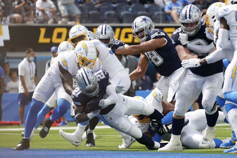 Dallas Cowboys running back Ezekiel Elliott (21) scores a touchdown during the first half of an NFL football game against the Los Angeles Chargers Sunday, Sept. 19, 2021, in Inglewood, Calif. (AP Photo/Ashley Landis )