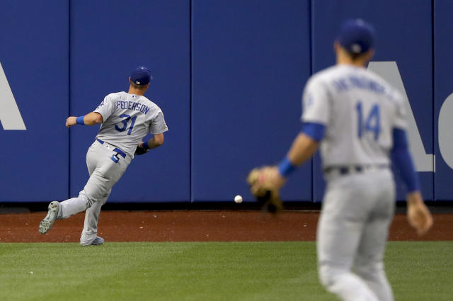 Los Angeles Dodgers left fielder Joc Pederson (31) chases down an RBI double by New York Mets' Jose Bautista during the second inning of a baseball game Saturday, June 23, 2018, in New York. (AP Photo/Julie Jacobson)