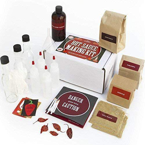 """<p><strong>DIY Gift Kits</strong></p><p>amazon.com</p><p><strong>$56.95</strong></p><p><a href=""""https://www.amazon.com/dp/B01L0XFW8U?tag=syn-yahoo-20&ascsubtag=%5Bartid%7C2140.g.27889813%5Bsrc%7Cyahoo-us"""" rel=""""nofollow noopener"""" target=""""_blank"""" data-ylk=""""slk:Shop Now"""" class=""""link rapid-noclick-resp"""">Shop Now</a></p><p>For the hot sauce enthusiast who's ready to take the next step with their hobby, this DIY hot sauce kit is perfect. Your dad can get creative with flavors and, if you're lucky, share his latest concoctions with the fam. </p>"""